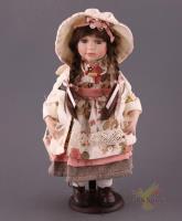 Кукла фарфоровая высота=43 см.